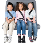 SafeGuard FlexSeat is shown with three elementary age school children buckled up on the seat.