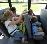 Two rows of students buckled up in their SafeGuard lap-shoulder belts on the school bus.