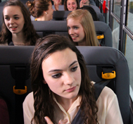 Students buckled up on their school bus.