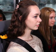 A high school girl sits buckles into her SafeGuard seat belt.