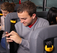 A high school student buckles up in his SafeGuard lap-shoulder belt.