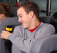 A high school students buckles up on his school bus in a SafeGuard seat.