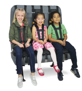 Three children sit on a school bus seat in their SafeGuard SuperSTARS.